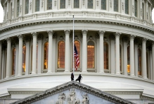 The American flag is lowered to half-staff over the U.S. Capitol following the bombing at the Boston Marathon. (Photo credit: AP)